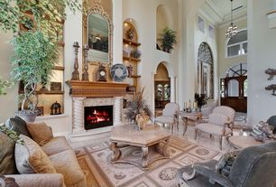 Traditional Living Room with Concrete floors, Built-in bookshelf, Fireplace, can lights, Cathedral ceiling, brick fireplace