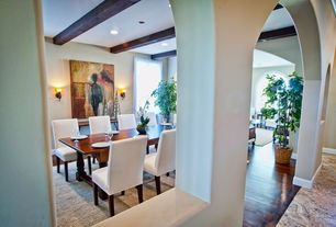 Mediterranean Dining Room with Exposed beam, Carpet, Wall sconce, Hardwood floors, can lights, Mural, Standard height