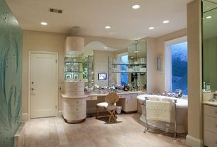 Traditional Master Bathroom with Flush, Bathtub, Limestone, European Cabinets, stone tile floors, flat door, picture window
