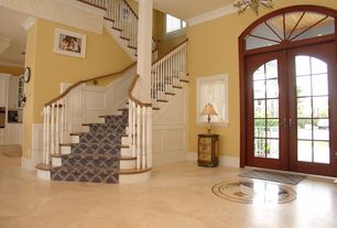 Traditional Exterior of Home with Double door, Carpet stair runner, Transom window, French doors, High ceiling