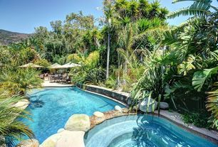 Rustic Swimming Pool with exterior stone floors, Pool with hot tub