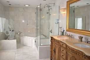 Eclectic Master Bathroom with Concrete tile , frameless showerdoor, Raised panel, Inset cabinets, Wall sconce, Double sink