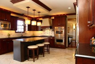 Traditional Kitchen with L-shaped, Vinyl floors, Kitchen island, Flat