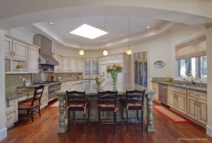 Traditional Kitchen with High ceiling, Kitchen island, U-shaped, Hardwood floors, Skylight, Breakfast bar, Raised panel