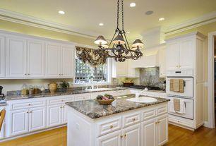 Traditional Kitchen with Custom hood, Raised panel, Crown molding, Hardwood floors, Chandelier, Kitchen island, Onyx counters