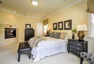 Modern Guest Bedroom with metal fireplace, Crown molding, Carpet, flush light