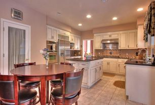 Traditional Kitchen with electric cooktop, can lights, stone tile floors, double wall oven, Soapstone counters, U-shaped