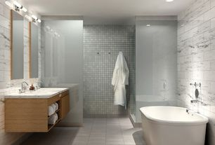 Contemporary Master Bathroom with bathroom sink, Standard height, custom shower, dual shower, linen and towel storage cabinet