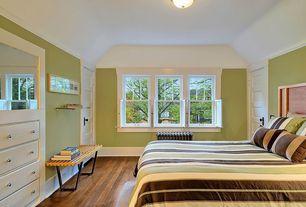 Modern Guest Bedroom with Crown molding, flush light, Hardwood floors