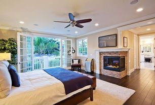 "Traditional Guest Bedroom with Progress Lighting 54"" AirPro 5 Blade Patio Ceiling Fan, French doors, Sauna, Carpet"