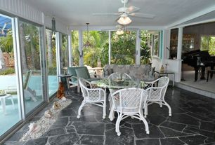 Tropical Great Room with Sunken living room, Wainscotting, Pendant light, flush light, Ceiling fan, Casement, French doors