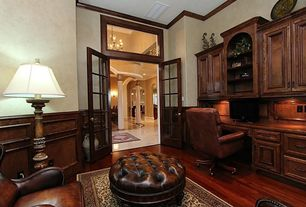 Traditional Home Office with Crown molding, Chair rail, Wainscotting, Transom window, Hardwood floors, French doors