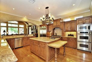 Mediterranean Kitchen with built-in microwave, gas range, Chandelier, Stainless steel appliances, double wall oven, Galley