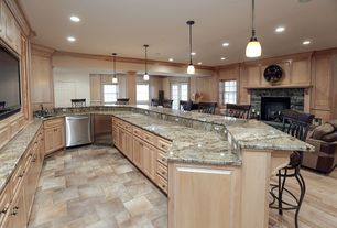 Traditional Kitchen with Undermount sink, One-wall, Breakfast bar, Crown molding, Raised panel, Pendant light, Columns