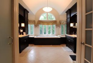 Contemporary Master Bathroom with Vinyl floors, Simple marble counters, Flat panel cabinets, Arched window, Undermount sink