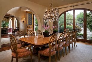 Traditional Dining Room with French doors, Hardwood floors, Chandelier, Standard height