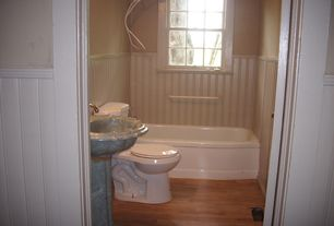 Cottage Full Bathroom with Wainscotting, Full Bath, Bathtub, Hardwood floors, stone slab showerbath, shower bath combo