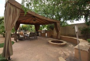Modern Patio with Outdoor kitchen, Fire pit, Fence, Raised beds, exterior stone floors