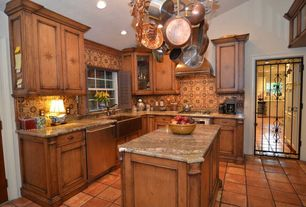 Eclectic Kitchen with specialty door, wall oven, Flat panel cabinets, Glass panel, Kitchen island, L-shaped, electric cooktop