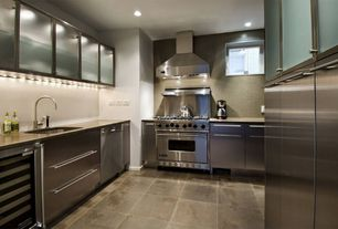 Contemporary Kitchen with Casement, Wall Hood, dishwasher, European Cabinets, gas range, Concrete counters, Flush, U-shaped