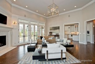 Contemporary Living Room with Transom window, High ceiling, Bamboo floors, Chandelier, Crown molding, Wall sconce