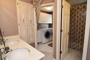 Eclectic Laundry Room with six panel door, can lights, Standard height, Concrete tile , drop-in sink, specialty door