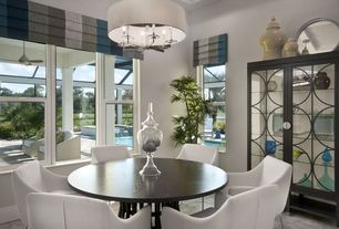 Contemporary Dining Room with Concrete tile , Chandelier
