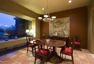 Traditional Dining Room with Chandelier, terracotta tile floors