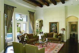 Traditional Living Room with Laminate floors, Carpet, Transom window, Exposed beam, Custom built glass shelving, French doors
