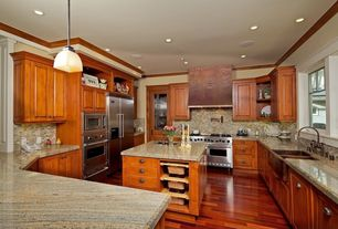 Country Kitchen with full backsplash, wall oven, U-shaped, gas range, Laminate floors, can lights, Framed Partial Panel