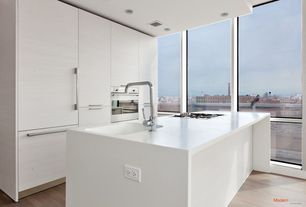 Contemporary Kitchen with Laminate floors, Simple marble counters, Kitchen island, European Cabinets, Flush, One-wall