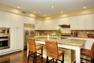 Traditional Kitchen with Kubu counterstool, L-shaped, Stone Tile, Kitchen island, Simple granite counters, Breakfast bar