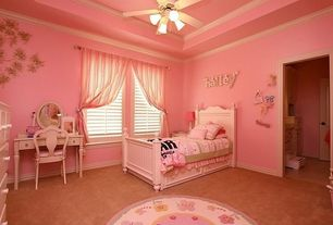 Traditional Kids Bedroom with Standard height, flush light, Ceiling fan, Concrete floors, Crown molding, specialty window