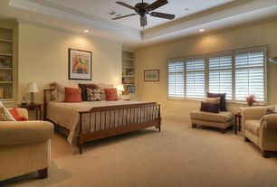 Modern Guest Bedroom with Built-in bookshelf, Carpet, High ceiling, can lights, picture window, Ceiling fan, specialty window