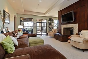 Modern Home Theater with Laminate floors, Glass panel door, Fireplace, can lights, French doors, insert fireplace