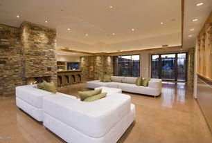 Modern Living Room with Contemporary leather couch, French doors, High ceiling, stone fireplace, Lighted soffit