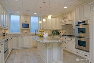 Traditional Kitchen with Pendant light, can lights, Raised panel, dishwasher, Framed Partial Panel, U-shaped, Standard height