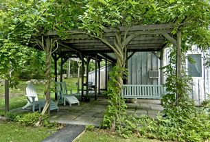 Cottage Landscape/Yard with Trellis, Pathway, exterior stone floors, Pergola, Outdoor seating, Paint, picture window