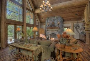 Rustic Living Room with Cathedral ceiling, Chandelier, Exposed beam, stone fireplace, Custom Rustic Stone Fireplace