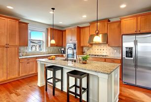 Traditional Kitchen with Flat panel cabinets, Large Ceramic Tile, Hardwood floors, Breakfast bar, Pendant light, L-shaped
