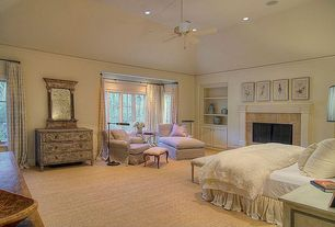 Traditional Guest Bedroom with Carpet, Cement fireplace, Ceiling fan, Built-in bookshelf, Crown molding