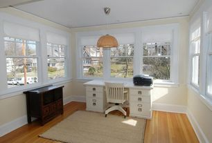 Cottage Home Office with Crown molding, Laminate floors, Carpet, Wainscotting, Pendant light