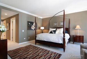 Contemporary Guest Bedroom with Concrete floors, Crown molding