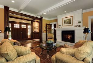 Craftsman Living Room with Glass panel door, Cement fireplace, Exposed beam, Laminate floors, French doors, Pendant light