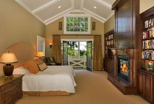 Traditional Master Bedroom with specialty window, can lights, insert fireplace, Crown molding, High ceiling, metal fireplace