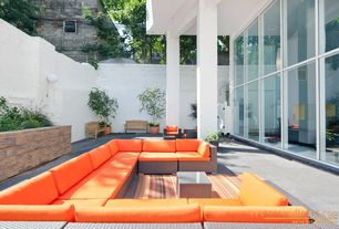Contemporary Patio with Fence, Raised beds, picture window, exterior stone floors