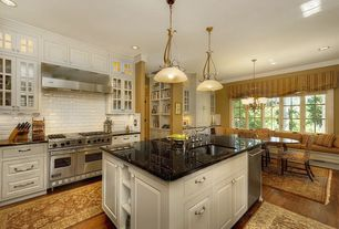 "Traditional Kitchen with Simple granite counters, full backsplash, Viking - 48"" gas range - vgcc, Glass panel, Window seat"