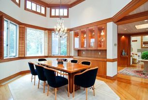 Craftsman Dining Room with Chandelier, Crown molding, Hardwood floors, Built-in bookshelf, Cathedral ceiling