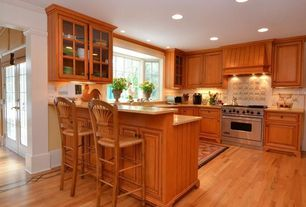 Traditional Kitchen with Simple marble counters, full backsplash, Framed Partial Panel, can lights, Crown molding, U-shaped