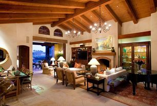 Eclectic Great Room with complex granite floors, High ceiling, Exposed beam, Chandelier, Built-in bookshelf
